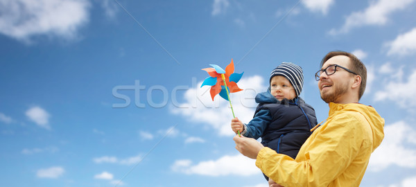 Stock photo: happy father and son with pinwheel toy outdoors