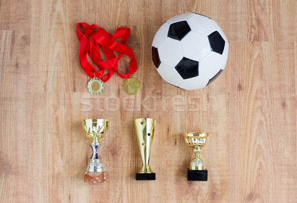 football or soccer ball, golden cups and medals Stock photo © dolgachov