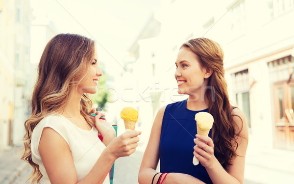 woman with shopping bags and ice cream in city Stock photo © dolgachov