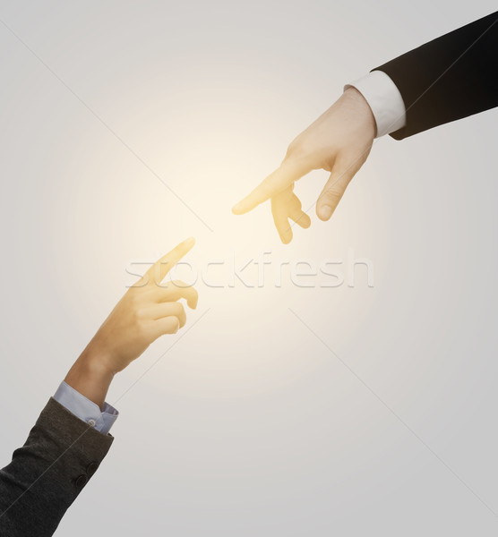 woman and man hands trying to connect Stock photo © dolgachov