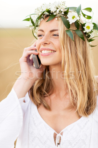 happy young woman calling on smartphone at country Stock photo © dolgachov