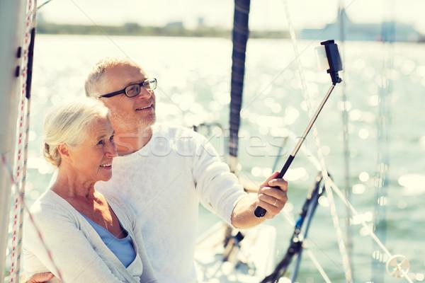 Pareja de ancianos toma vela barco yate vela Foto stock © dolgachov