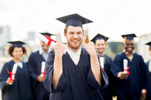 Stockfoto: Gelukkig · student · diploma · vieren · afstuderen · onderwijs