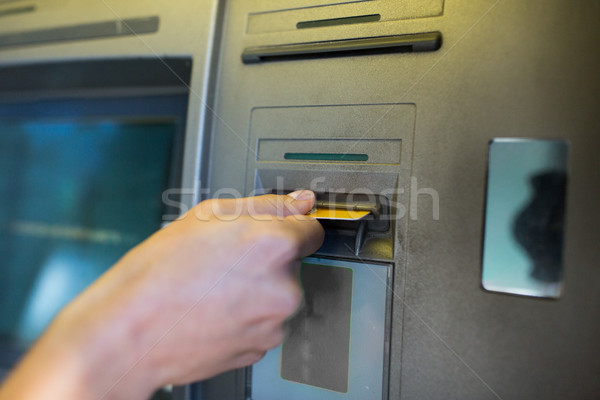 close up of hand inserting card to atm machine Stock photo © dolgachov