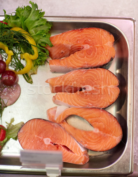 salmon fish fillet in metal tray on ice at grocery Stock photo © dolgachov
