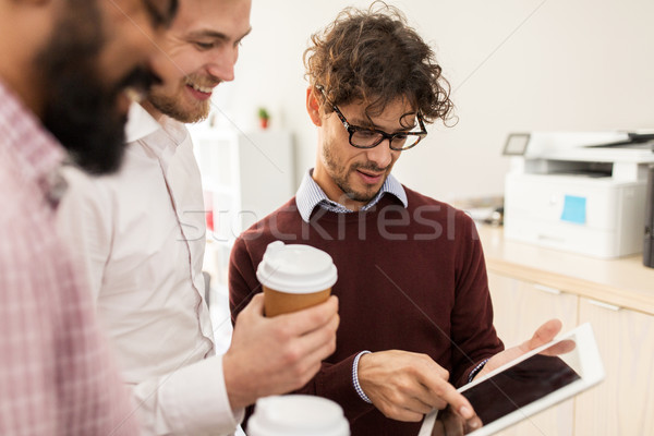 business team with tablet pc and coffee at office Stock photo © dolgachov