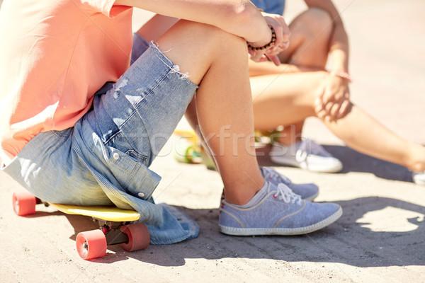 Stock photo: teenage couple with skateboards on city street