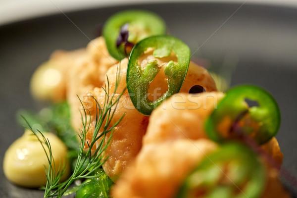 close up of king prawns with jalapeno Stock photo © dolgachov