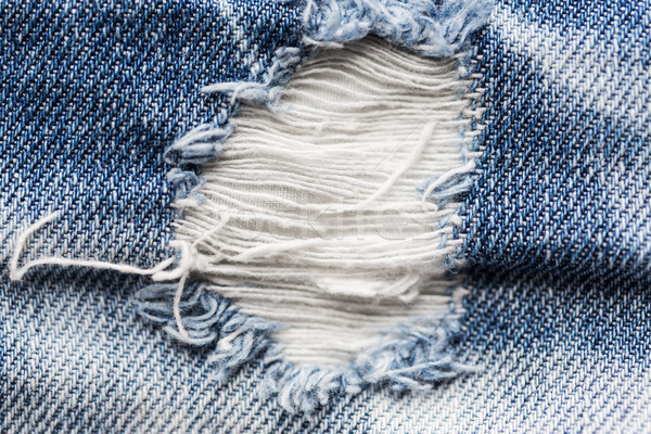Gat haveloos denim jeans kleding Stockfoto © dolgachov