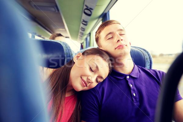happy couple or passengers sleeping in travel bus Stock photo © dolgachov