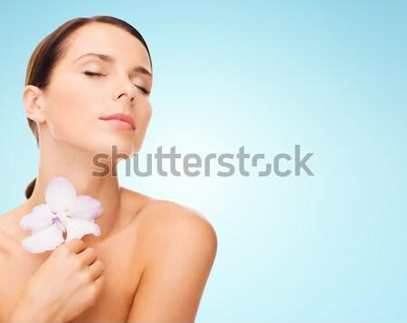 Gyönyörű fiatal nő orchidea virág szépség emberek Stock fotó © dolgachov