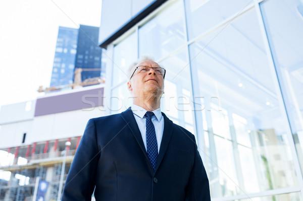 senior businessman on city street Stock photo © dolgachov