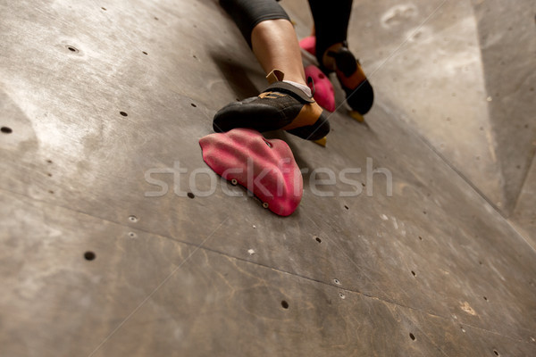 foot of woman exercising at indoor climbing gym Stock photo © dolgachov
