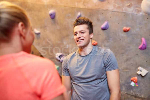 man and woman talking at indoor climbing gym wall Stock photo © dolgachov