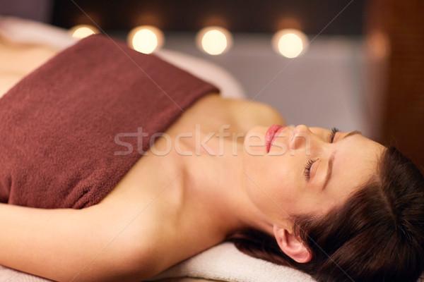 happy young woman lying at spa or massage parlor Stock photo © dolgachov