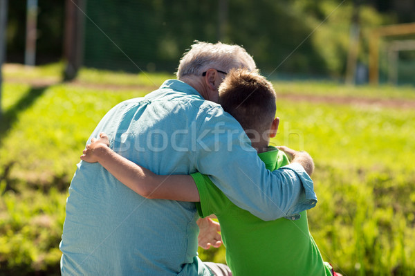 grandfather and grandson hugging outdoors Stock photo © dolgachov