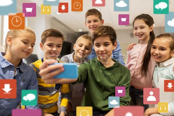 group of school kids taking selfie with smartphone Stock photo © dolgachov