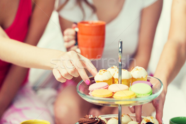 friends or teen girls eating sweets at home Stock photo © dolgachov