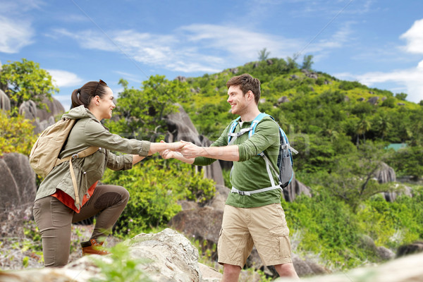 couple with backpacks traveling over exotic island Stock photo © dolgachov