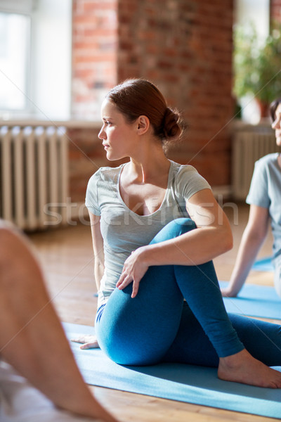 woman with group of people doing yoga at studio Stock photo © dolgachov