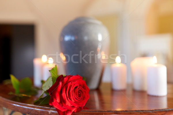 red rose and cremation urn with burning candles Stock photo © dolgachov