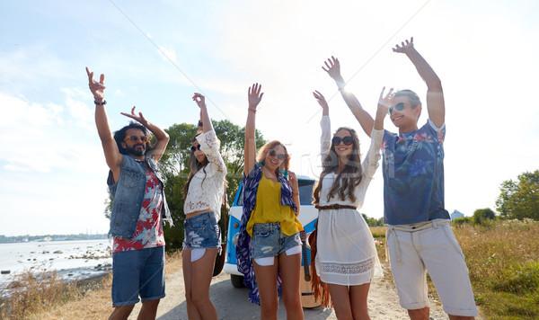 smiling hippie friends having fun near minivan car Stock photo © dolgachov
