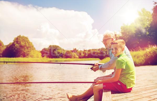 Nagyapa unoka halászat folyó család generáció Stock fotó © dolgachov