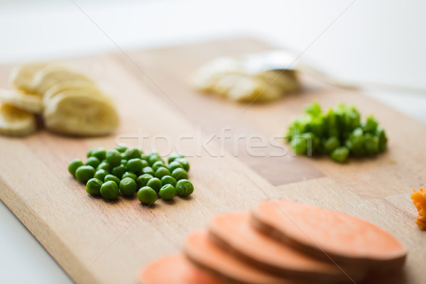 peas and other vegetables on wooden board Stock photo © dolgachov