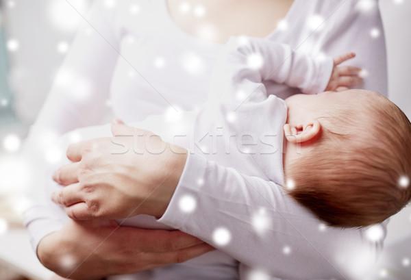 close up of mother holding newborn baby Stock photo © dolgachov