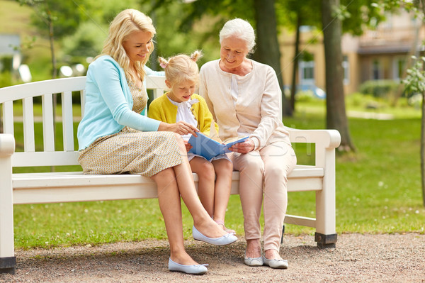 Stock photo: woman with daughter and senior mother at park