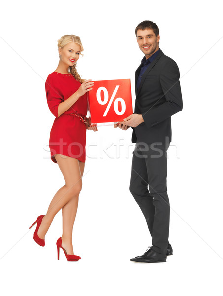 man and woman with percent sign Stock photo © dolgachov