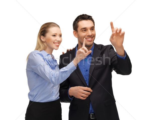 man and woman working with something imaginary Stock photo © dolgachov