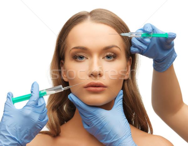Volto di donna mani foto ragazza medico blu Foto d'archivio © dolgachov