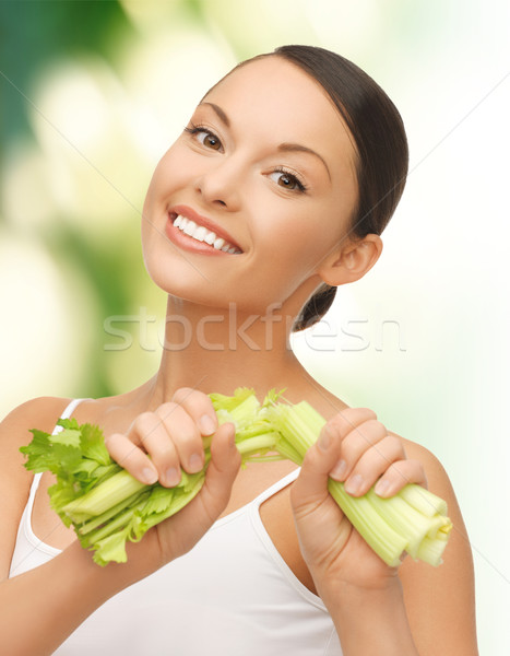 Nő friss zeller kép gyönyörű nő fitnessz Stock fotó © dolgachov