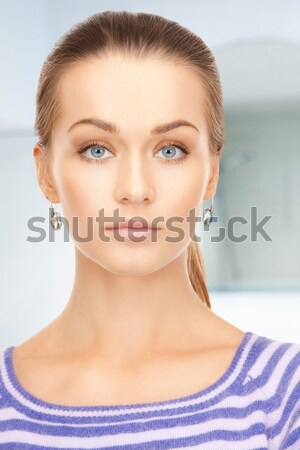 lovely woman in striped sweater Stock photo © dolgachov