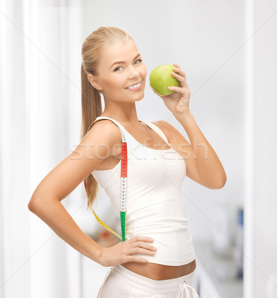sporty woman with apple and measuring tape Stock photo © dolgachov