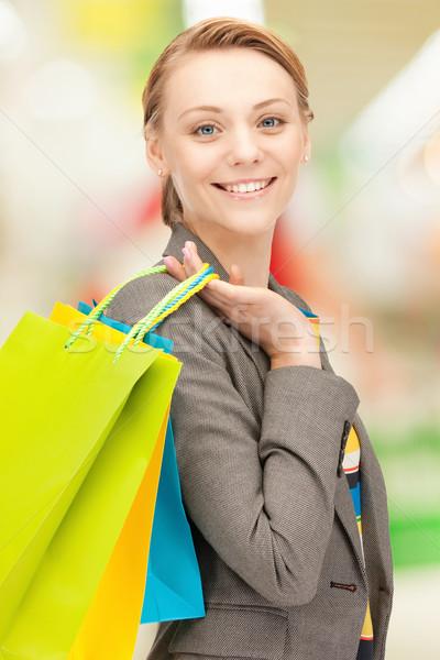 ストックフォト: 買い物客 · 画像 · 女性 · ショッピングバッグ · 幸せ · ショッピング