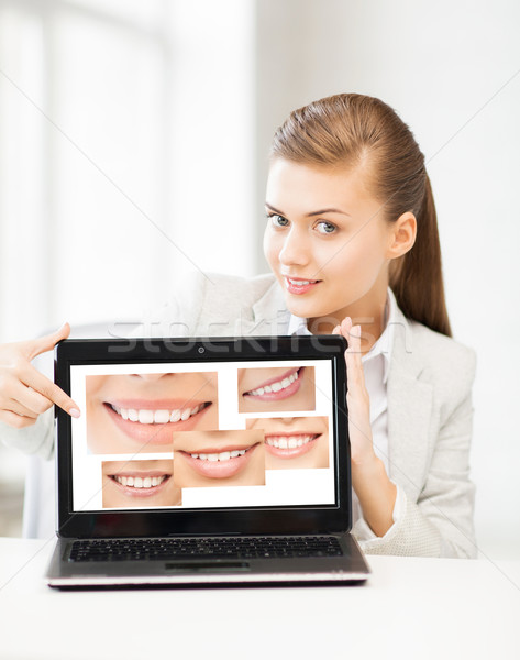 woman with laptop and smiles Stock photo © dolgachov