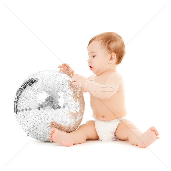 child playing with disco ball Stock photo © dolgachov