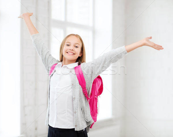 student girl with hands up at school Stock photo © dolgachov