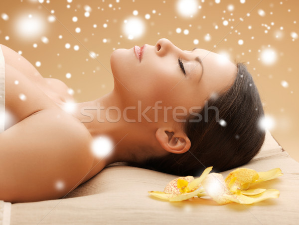 woman in spa salon lying on the massage desk Stock photo © dolgachov