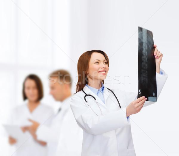 Stok fotoğraf: Gülen · kadın · doktor · bakıyor · xray · sağlık