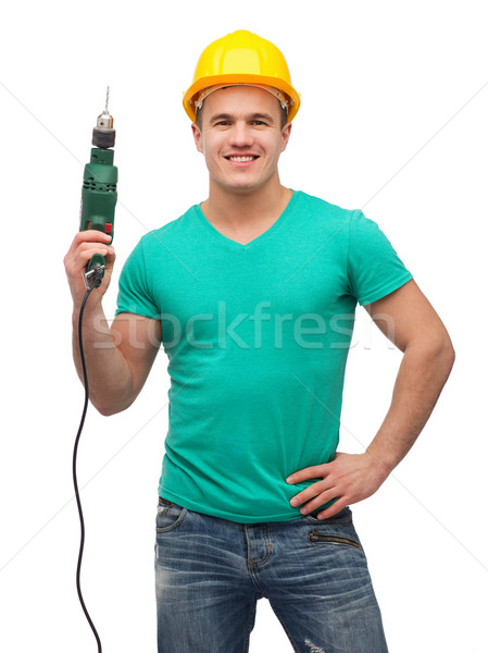 smiling manual worker in helmet with drill machine Stock photo © dolgachov