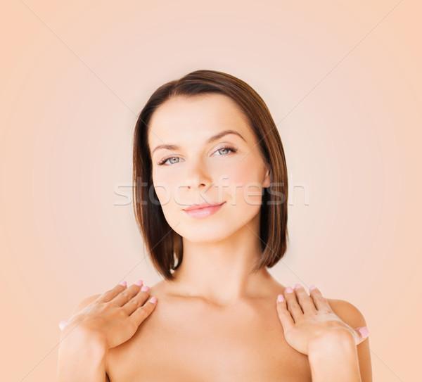 Bela mulher tocante ombros saúde pessoas Foto stock © dolgachov