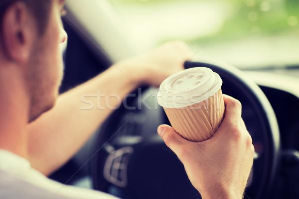 man drinking coffee while driving the car Stock photo © dolgachov