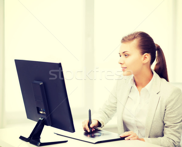 Stock photo: businesswoman with drawing tablet in office