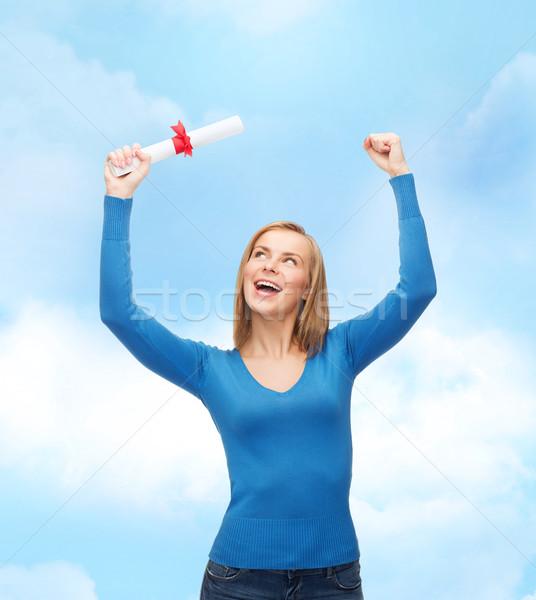 Gülümseyen kadın diploma üniversite eğitim kadın gökyüzü Stok fotoğraf © dolgachov