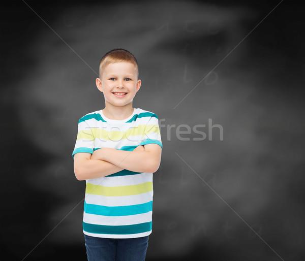 Pequeno menino casual roupa felicidade Foto stock © dolgachov
