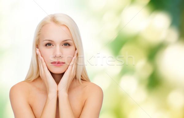 beautiful woman touching her face skin Stock photo © dolgachov