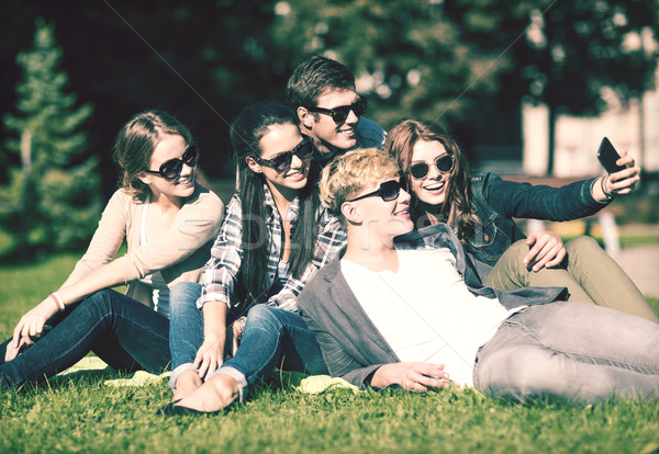 Stock photo: teenagers taking photo outside with smartphone